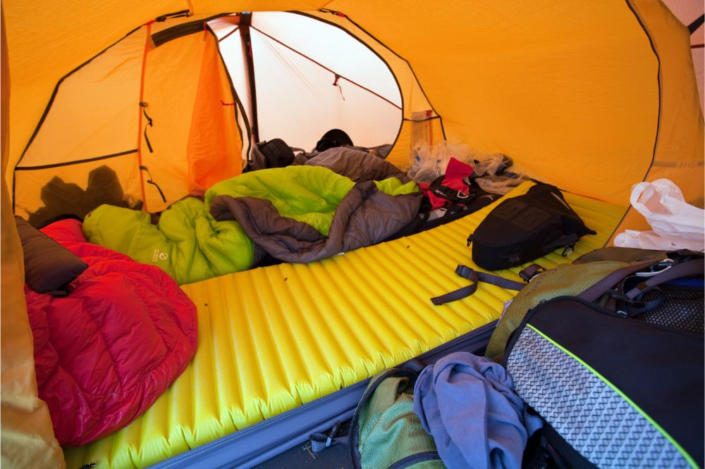 inflatable sleeping pad inside a tent
